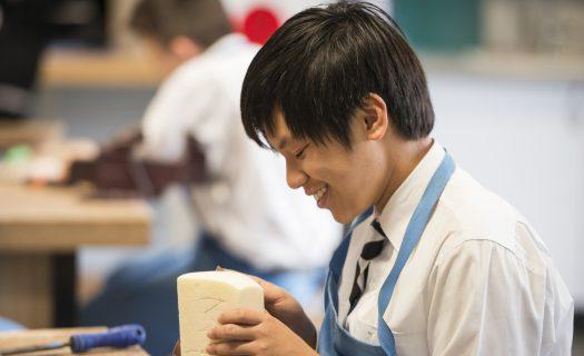 smiling_boy_woodwork