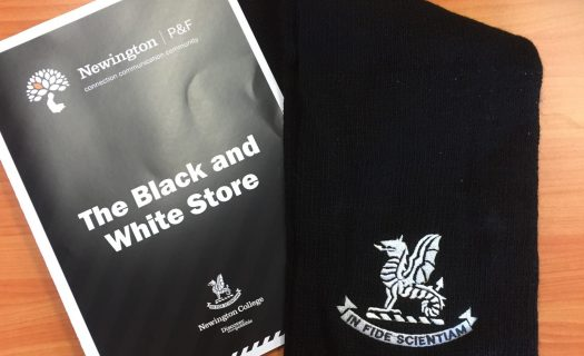 A photo of a Newington College knit scarf and Black and White store price booklet.