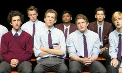 Cast sit together on stage for 'Michael Swordfish' production