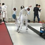 Members of the fencing team in competition