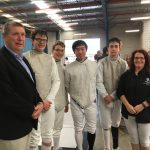 Members of the fencing team gather for a group photo with Headmaster David Mulford