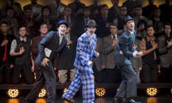 a group photo of actors on stage for the production 'Guys and Dolls'