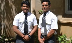 Two students from Tonga stand for a photo on campus