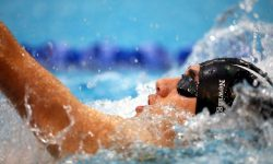 A photo of a swimmer doing the backstroke in the pool