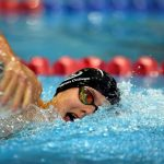 A photo of a Newington College swimmer in competition