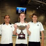swimmers hold their trophy at the AAGPS Swimming championships