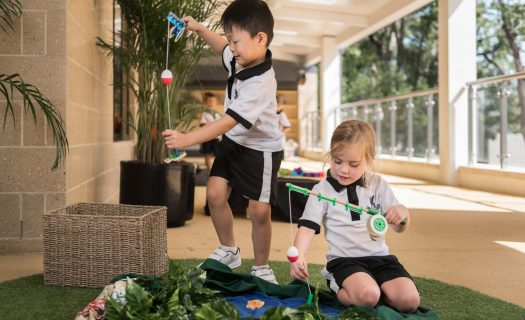 A boy and girl play at the ELC.