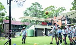 Boys play basketball during recess at Lindfield Prep