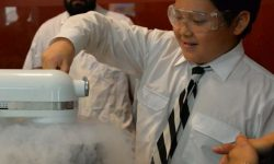 A student works with dry ice and a food mixer during the Newington College STEM Festival