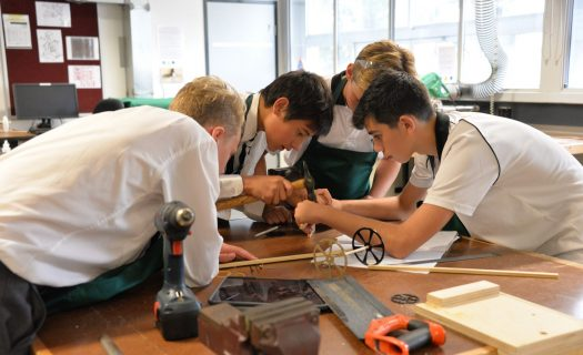 A group of boys work together during a STEM Festival session.