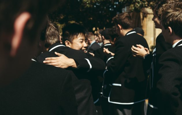 Boys hug on Valedictory Day.