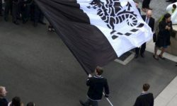 Students carry the Newington College Flag on the Stanmore campus