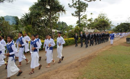 Newington College students and Tupou College students walk together in Tonga