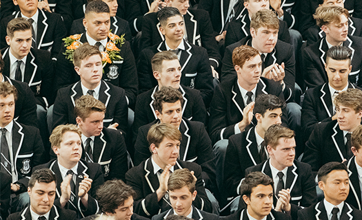 The Class of 2018 sits together at their Valedictory Assembly