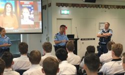 A photo of NSW police talking with students about adolescent risk taking