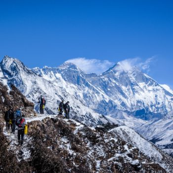 Students stand on top of a mountain in Nepal