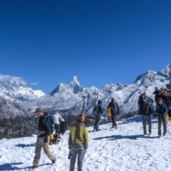 Students on top of a mountain in Nepal