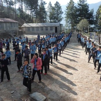 Students at Nepal school give outdoor performance.