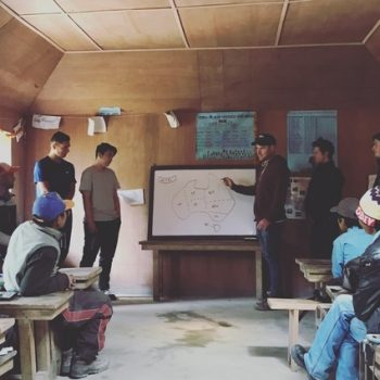 Students and teachers in a classroom in Nepal