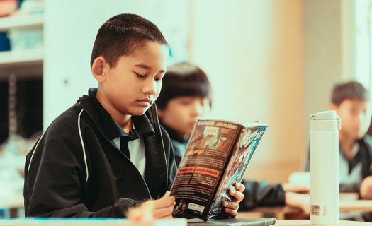 A student reads a graphic novel