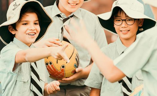 Boys passing a ball