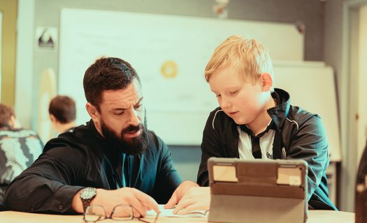 Student and teacher working with technology