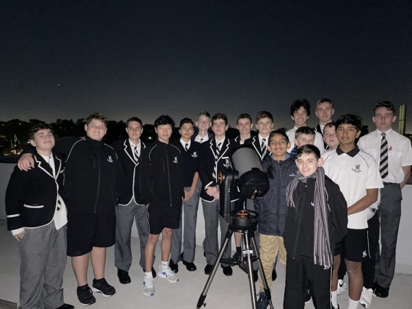 Boys looking through the telescope for Stargazing at the College